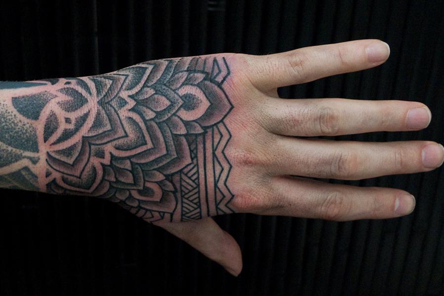 hand tattoo thomas hooper