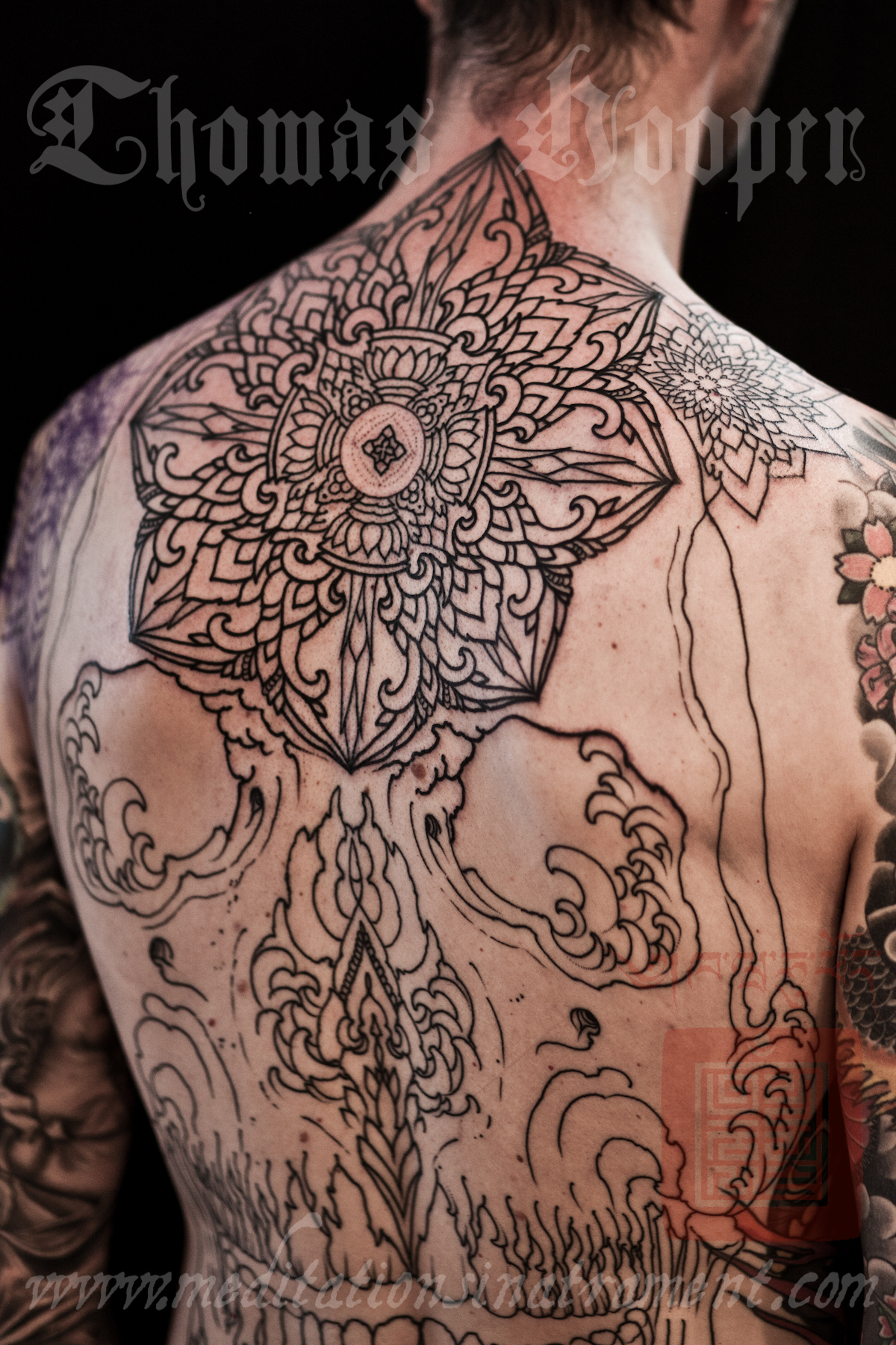 skull back piece tattoo